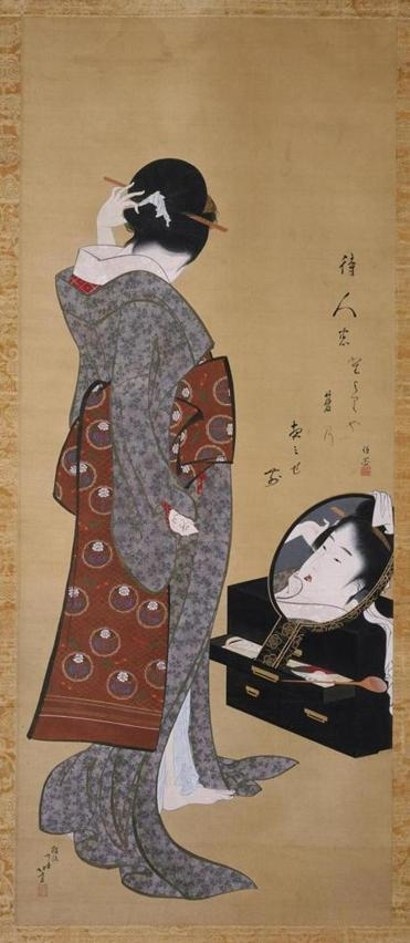 """Woman Looking at Herself in a Mirror"" is part of the ""Hokusai"" exhibition at the Museum of Fine Arts."